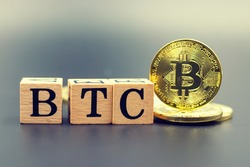 Bitcoin is on green grass. BTC is the first decentralized cryptocurrency created. There is no central authority that controls Bitcoin.