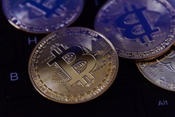 bitcoin is place on the keyboard of the laptop, cryptocurrency trading technology concept.