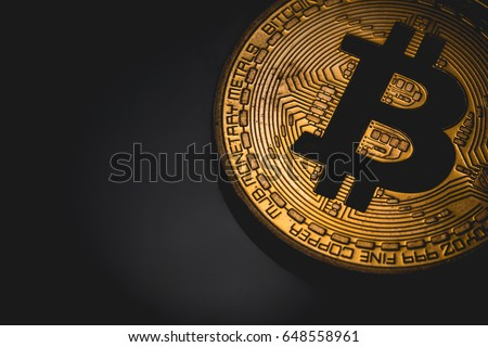 bitcoin logo in the dark