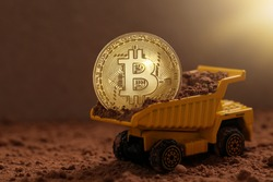 Bitcoin mining concept. Mining dump truck, tipper big heavy yellow car, Bitcoin coins, Martian red surface. Cryptocurrency.