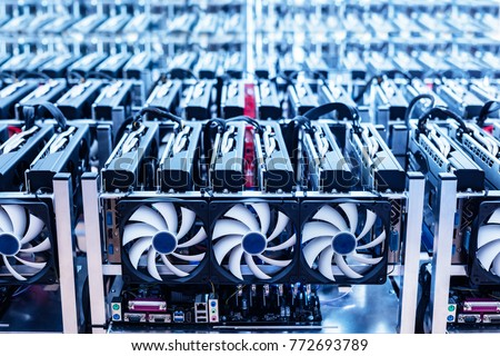 Bitcoin mining farm. IT hardware. Electronic devices with fans. Cryptocurrency miners.