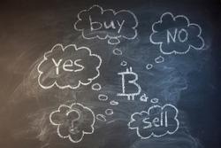 Bitcoin on blackboard with chalk.