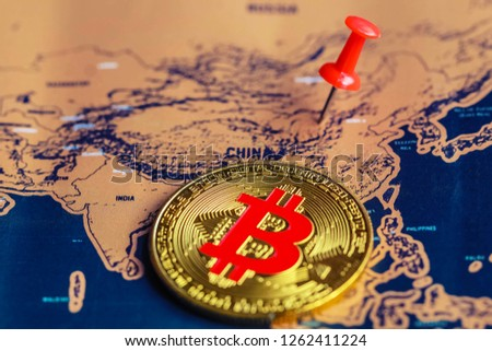 Bitcoin on China part of world map. Regulations of cryptocurrency in China concept. Selective focus.