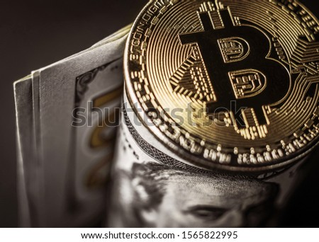 Bitcoin on paper usd banknote, close-up. Money of the future, cryptocurrency concept