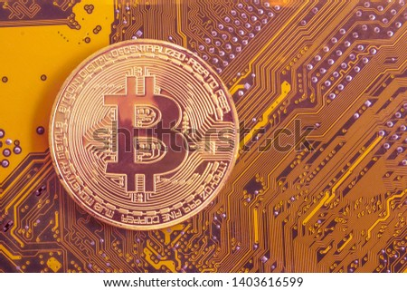 bitcoin on the background of the electronic circuit. electronic currency. #1403616599