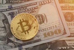 Bitcoin on USD united states dollar currency hundreds and twenties.  Overtake fiat currency with copyspace for text.