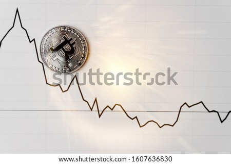 Bitcoin on white graph. New online currency. Currency of the future.