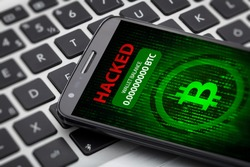 bitcoin wallet hacked message on smart phone screen. cryptocurrency theft concept