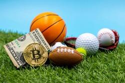 Bitcoin with American football tennis ball golf ball baseball basketball on green grass for future betting currency