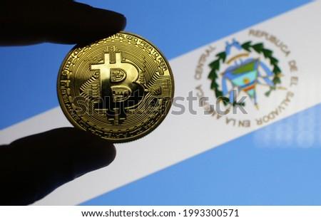 Bitcoin with El Salvador flag background selective focus at the coin  Stok fotoğraf ©