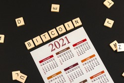Bitcoin world news, 2021 calendar on black background, theme of crypto currency, photo of word