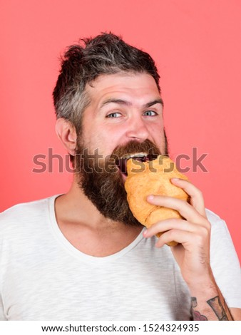 Biting croissant. Delicious breakfast. Man start morning with croissant. Bearded hipster enjoy breakfast. Yummy croissant. Fresh baked croissant. Calories and gluten. Diet and dieting. Bakery concept.