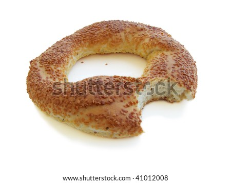 Bitten bagel with sesame isolated on white