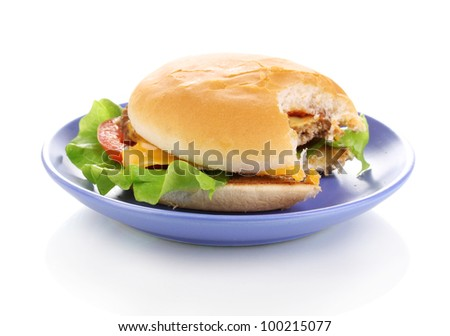 Bitten cheeseburger on plate isolated on white