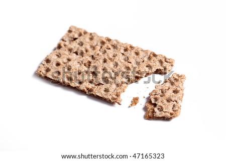 bitten crispbread on white background - stock photo