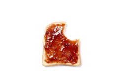 bitten slice of toasted bread with strawberry jam  with copy space for your text
