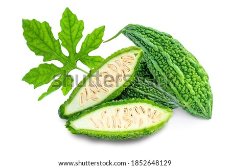 Bitter melon ( bitter gourd, bitter cucumberor Momordica charantia ) with slice and green leaf isolated on white background.