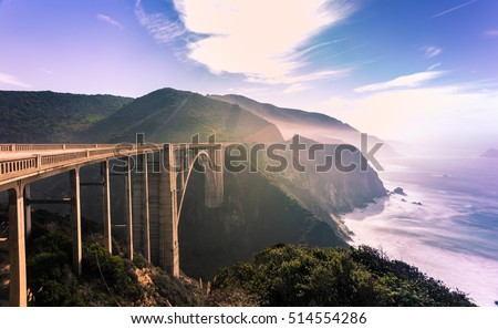 Bixby bridge,scenic ocean view point at Big Sur,highway 1 coastline scenic road,Carmel,California with horizon turquoise crazy wave of Pacific ocean with toned color and long exposure photographic
