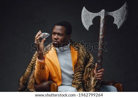 Bizarre african guy with huge axe and diamond Stock fotó ©