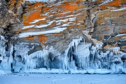 Bizarre ice figures on the coastal cliffs of Lake Baikal. Irkutsk region, Russia