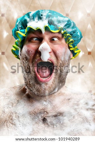 Bizarre man with soap foam on nose taking bath