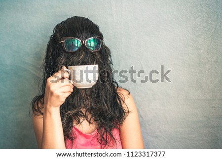 Bizarre woman / Woman's face is covered with hair while she drinks coffee in the cup