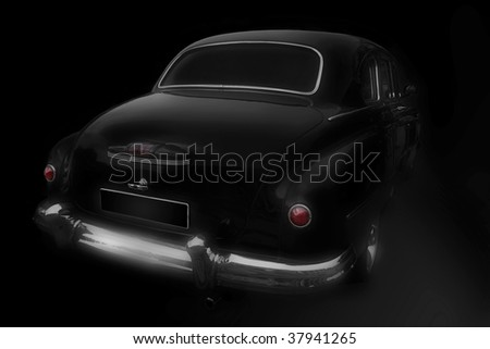 Black a retro the car on a black background. A software a lens