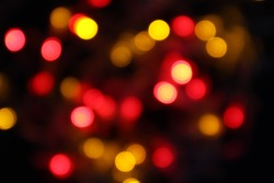 black abstract background of defocused bokeh colorful blurred beautiful shiny illuminate for Christmas celebration party