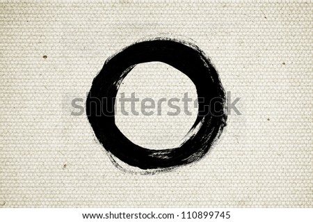 Black abstract hand-painted brush stroke daub circle over vintage old paper