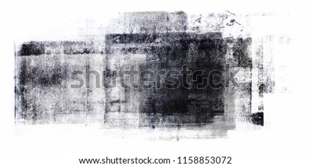 Black acrylic paint rolled in abstract shape on white paper background