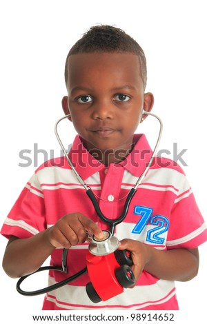Black African American child with stethoscope and car isolated metisse hair curly