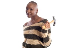 Black African American female model holding a hammer repair tool looking independent and self reliant.  She is depicting home improvement and woman individualism.