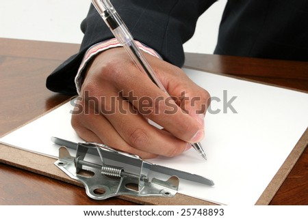 Black African American hand in business suit signing document paper contract with ink pen.
