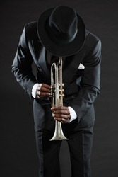 Black african american jazz trumpet player. Vintage. Studio shot.