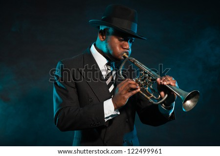 Black african american jazz trumpet player. Vintage. Studio shot.