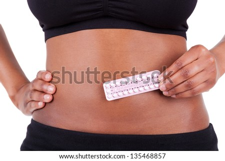 Black african american woman holding contraceptive solutions, isolated on white background -  African people