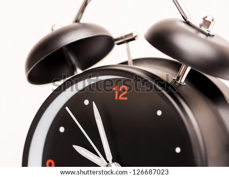 black alarm clock on light background