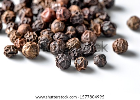 black allspice peppercorns close-up scattered on white  background #1577804995