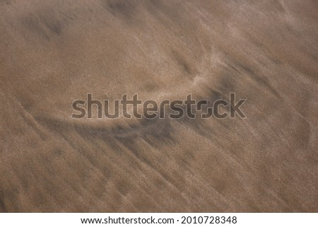 Black and brown sand at the beach at Ma'alaea Bay in Kihei, Maui, Hawaii, USA Stok fotoğraf ©