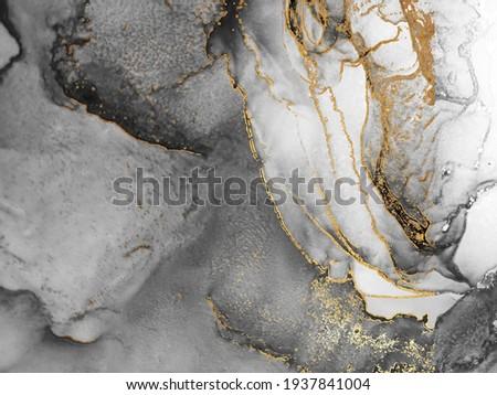 Black and Gold Alcohol Ink. Fantastic Wallpaper. Golden Liquid. Decoration Gouache. Dust Gouache drawn. Airy Paint. Liquid Art Gold Divorces on Black.