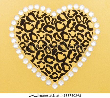 ... animal print heart surrounded by white rhinestones on gold background