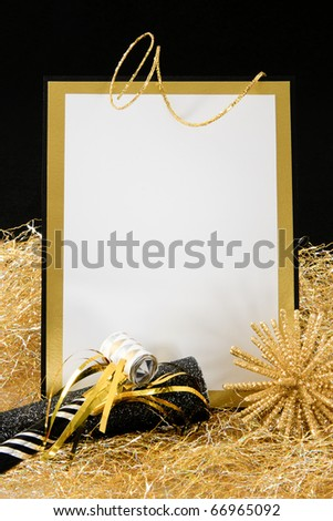 Black and Gold Blank Invitation or Sign with Copy-Space accented with Party Favors