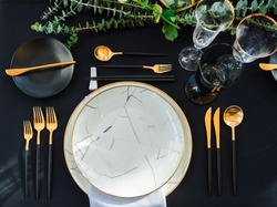 Black and gold color Luxury table elegant set for Wedding reception in barn.Waiting for the guest