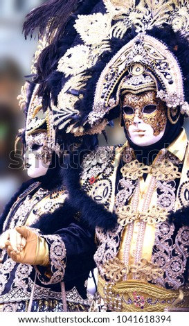 Black and Gold Venetian Costumes #1041618394