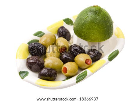 Black and green Olives and Lime in a plate isolated on white with clipping path