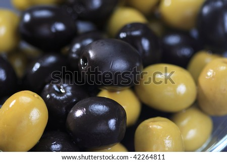 Black and green olives closeup photo selective focus