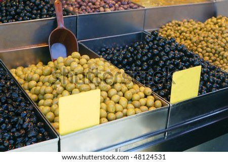 black and green olives on market stand