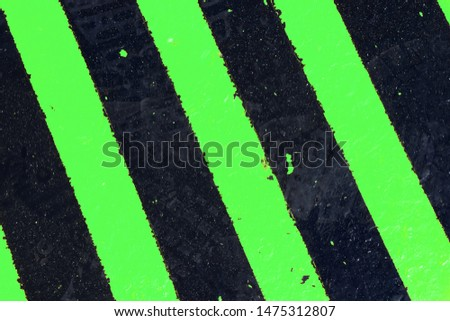 Black and green road surface, texture. Background, surface.