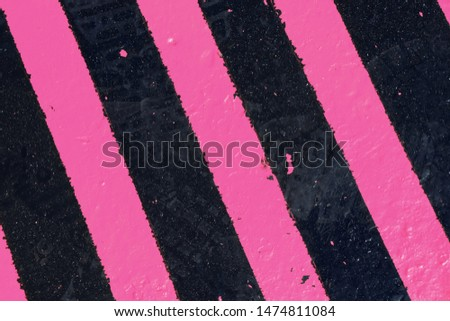 Black and pink road surface, texture. Background, surface.