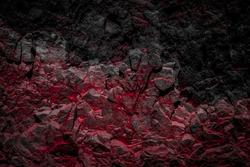 black and red colored rocks / rock wall background -